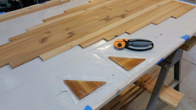 cutting cloth for transom braces.jpg